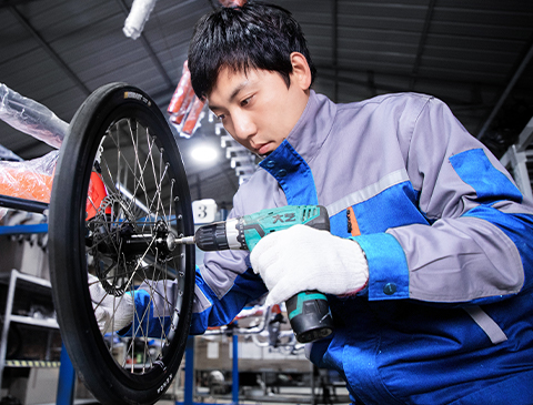 worker assembling Motrike's products