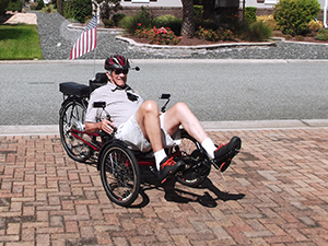 a client riding recumbent tricycles